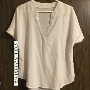 White V-Neck high low blouse.